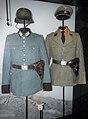 Norway in WW2. Nazi Germany police uniforms. Hauptwachtmeister Ordnungspolizei, Stahlhelm, holster; SS-Sturmmann Sicherheitsdienst SD, Totenkopf skull cap. Forsvarsmuseet (Armed Forces Museum) Oslo 2020-02-24 02902.jpg