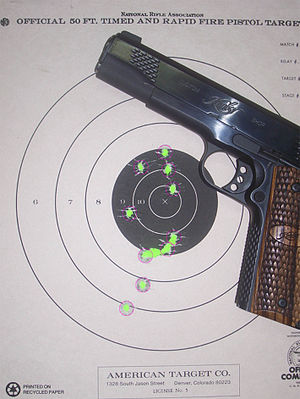 NRA Precision Pistol - Kimber Raptor with a paper target, 90-1X score.