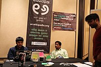 OFDN members Sailesh Patnaik and Jnanaranjan Sahu interacting with a guest at Wikimania 2018 (42972554804).jpg