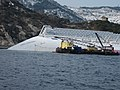 Ocean Crane Barge Meloria alongside the grounded and partially capsized Cruise ship Costa Concordia - 12 Feb. 2012.jpg