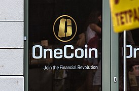 OneCoin logo on their office door in Sofia, Bulgaria (cropped).jpg