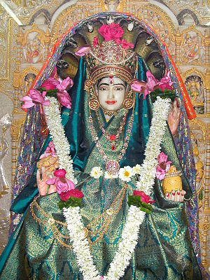 God in Jainism - Idol of Padmāvatī devī, śāsanadevī of Lord Parshvanatha at Walkeshwar Temple. She is one of the most popular demi-goddess amongst the Jains. According to Digambar Terapanth, worship of such deities is considered as mithyātva or wrong belief. However, in the Bispanthi Digambar tradition and the Shwetambar tradition, Padmavati is a popular Jain goddess.