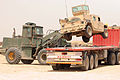 Payloader lifting Humvee.jpg