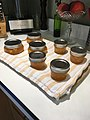 Peach jam cooling on wooden cutting board covered with kitchen towel.jpg