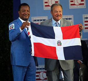 Sport in the Dominican Republic - Dominican icons - Pedro Martinez and Juan Marichal - together on stage with the Dominican flag.