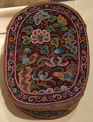Peranakan cut beads - A late 19th century Peranakan woman's ceremonial purse (tas manik) with velvet weave and glass cut beads.
