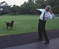 Photograph of President William Jefferson Clinton Throwing a Tennis Ball to Buddy the Dog- 07-11-1998 (6461539719) (cropped).jpg