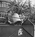 Pig Food- Women's Voluntary Service Collects Salvaged Kitchen Waste, East Barnet, Hertfordshire, England, 1943 D14248.jpg