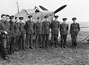 Pilots of No. 1 Squadron RCAF with one of their Hawker Hurricanes at Prestwick, Scotland, 30 October 1940. CH1733