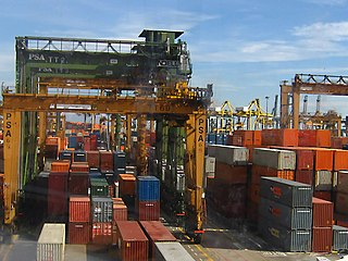 Container port facility where cargo containers are transshipped between different transport vehicles
