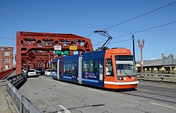 Portland Streetcar B-Loop car on Broadway Bridge (2016).jpg
