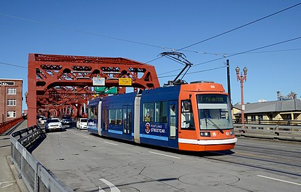 Opened in 2001, the Portland Streetcar was the first (non-heritage) tram network established in North America in decades. Portland Streetcar B-Loop car on Broadway Bridge (2016).jpg
