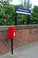 Post box outside Westhoughton railway station (geograph 4531853).jpg