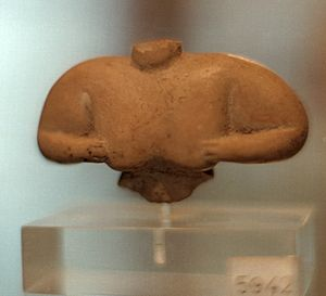 Sesklo - Torso of woman with hands on chest, small terracotta, Sesklo culture. Neolithic, c. 6000 BC — c. 5000 BC.