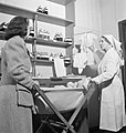 Pregnant war worker Irene Stacey listens to advice from a nursing sister at the ante-natal clinic in Bristol during 1942. D10437.jpg