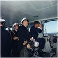 President views Atlantic Fleet Manuevers. Naval Aide Commander Tazewell Shepard, Commander Lang, President Kennedy.... - NARA - 194207.tif