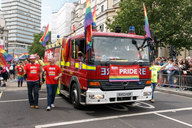 Pride in London 2016 - London Fire Brigade with fire engine participating in the parade.png