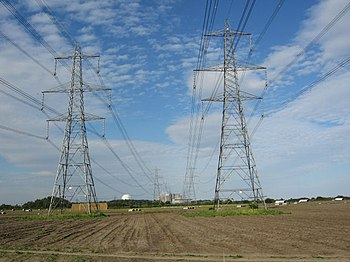 English: Pylons carrying power from the Sizewe...