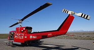Qaarsut Airport - Air Greenland Bell 212 helicopter shuttling passengers between Qaarsut and Uummannaq