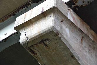 Rebar - Corroded concrete and rebar at the bridge of Queen Elizabeth Way crossing the Welland River in Niagara Falls, Ontario, Canada.