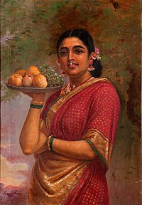 Indian woman with a plate of fruits