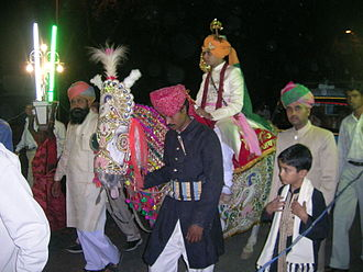 Wedding - Bridegroom arrives on horseback at a Rajput wedding