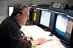 Rob Navias at console during STS-129 launch countdown (JSC2009-E-240946).jpg