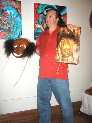 Booger Dance - Roger Cain (United Keetoowah Band mask-maker) showing a gourd booger mask (left) and a buffalo mask (right)