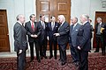 Ronald Reagan and George H. W. Bush meet with Congressional leaders after their inaugural ceremony in 1985.jpg