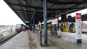 Berlin Wuhletal station - Platform with S- and U-Bahn trains