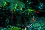 SERE specialists wait before performing static line jumps as the door of a C-130 Hercules opens over the Nevada Test and Training Range (25566922943).jpg