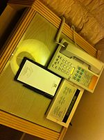 File:SK Korea tour 首爾 最佳西方 首爾花園酒店 Best Western Premier Seoul Garden Hotel room interior desk-top tel alarm clock Writing pad n pen July-2013.JPG