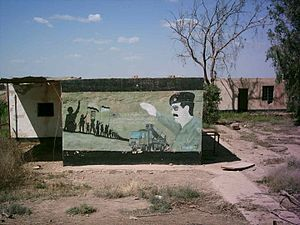 Camp Taji - Saddam art found on outside wall of abandoned building.