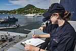 Sailor writes in a deck log as USS Green Bay moors pierside in Sasebo, Japan. (33639950163).jpg