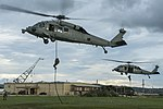 Sailors fast-rope from MH-60S Sea Hawk helicopters at Naval Base Guam. (35941071064).jpg