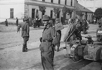 Occupation of Poland (1939–1945) - German and Soviet soldiers stroll around Sambir after the German-Soviet invasion of Poland. Their joint victory parade took place in Brześć.