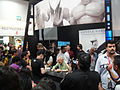 San Diego Comic-Con 2011 - Stan Lee signs at the Gentle Giant booth (5991540645).jpg