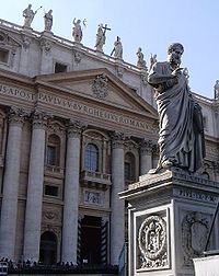 Saint Peter's Basilica in Rome. The statue in the foreground is of Saint Peter, held by the Catholic Church to be the first Pope.