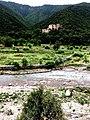 Satorra, Abbottabad. Fresh spring water stream, behind it an old fort.jpg