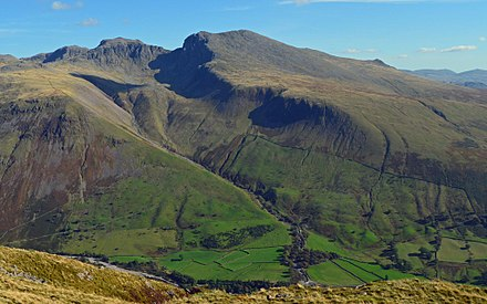 View of the Scafell massif from Yewbarrow, Wasdale, Cumbria. In the valley are older enclosures and higher up on the fell-side are the parliamentary enclosures following straight lines regardless of terrain.