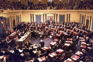 Impeachment in the United States - The impeachment trial of President Bill Clinton in 1999, Chief Justice William Rehnquist presiding. The House managers are seated beside the quarter-circular tables on the left and the president's personal counsel on the right, much in the fashion of President Andrew Johnson's trial.