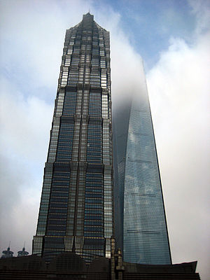 This is the pisture of Shanghai scyscrapers — Jin Mao Tower and Shanghai World Financial Center which disappears in the clouds.