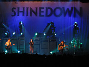 Rock band Shinedown performing at a concert.