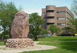 Lawrence City Hall with the Shunganunga Boulder in Robinson Park at the north end of Massachusetts Street.