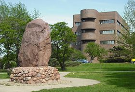 Shunganunga Boulder with City Hall.JPG