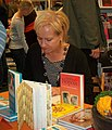 Sinikka Nopola signing books.JPG