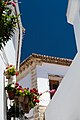 Small street with flowers and blue sky in Alhama de Granada, Andalousia, Spain - Picture Image Photography (14877086605).jpg