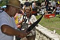 Smoking carps at the Carp Day Festival in Plavnica, Montenegro 06.jpg