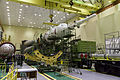 Soyuz TMA-06M spacecraft in the assembling facility.jpg