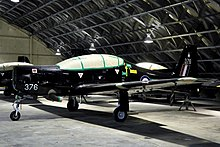 A RAF Shorts Tucano T1 in storage at RAF Shawbury.